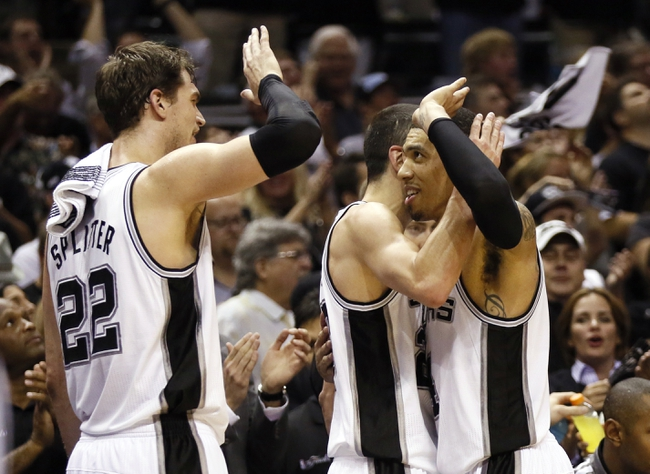 Jun 11, 2013; San Antonio, TX, USA; San Antonio Spurs shooting guard Danny Green (right) high fives shooting guard Manu Ginobili (center) and center Tiago Splitter (22) during the fourth quarter of game three of the 2013 NBA Finals against the Miami Heat at the AT&T Center.  Mandatory Credit: Soobum Im-USA TODAY Sports