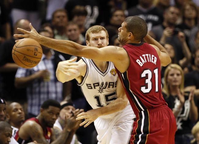 Jun 11, 2013; San Antonio, TX, USA; San Antonio Spurs power forward Matt Bonner (15) passes against Miami Heat small forward Shane Battier (31) during the fourth quarter of game three of the 2013 NBA Finals at the AT&T Center.  Mandatory Credit: Soobum Im-USA TODAY Sports