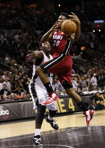 Jun 11, 2013; San Antonio, TX, USA; Miami Heat point guard Norris Cole (30) drives to the basket against San Antonio Spurs center DeJuan Blair (45) during the fourth quarter of game three of the 2013 NBA Finals at the AT&T Center. San Antonio Spurs won 113-77.  Mandatory Credit: Soobum Im-USA TODAY Sports