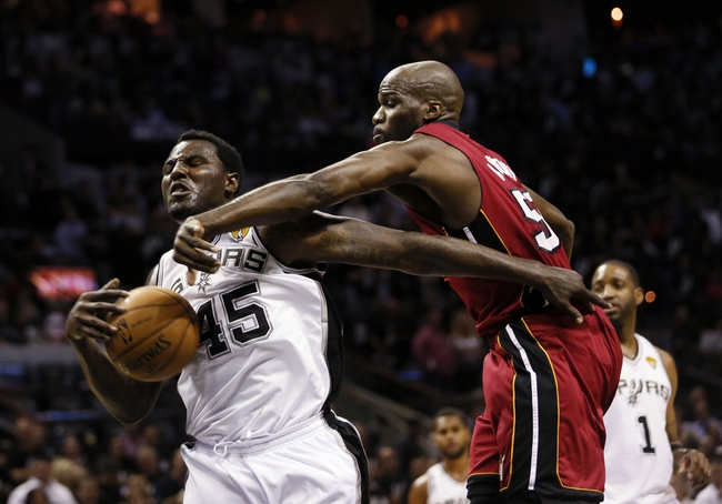 Jun 11, 2013; San Antonio, TX, USA; San Antonio Spurs center DeJuan Blair (45) and Miami Heat center Joel Anthony (50) go for a rebound during the fourth quarter of game three of the 2013 NBA Finals at the AT&T Center. San Antonio Spurs won 113-77.  Mandatory Credit: Soobum Im-USA TODAY Sports