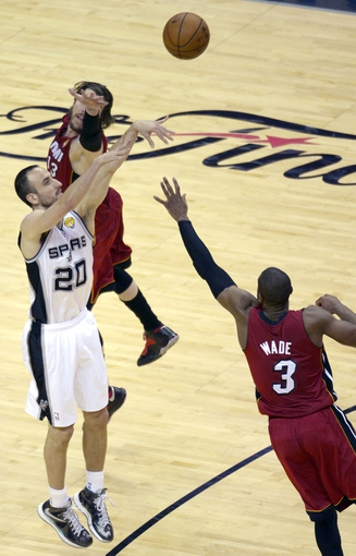 Jun 11, 2013; San Antonio, TX, USA; San Antonio Spurs shooting guard Manu Ginobili (20) shoots over Miami Heat shooting guard Dwyane Wade (3) in the third quarter during game three of he 2013 NBA Finals at the AT&T Center. Mandatory Credit: Brendan Maloney-USA TODAY Sports