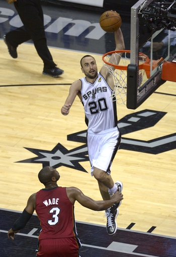 Jun 11, 2013; San Antonio, TX, USA; San Antonio Spurs shooting guard Manu Ginobili (20) dunks the ball ahead of Miami Heat shooting guard Dwyane Wade (3) in the third quarter during game three of he 2013 NBA Finals at the AT&T Center. Mandatory Credit: Brendan Maloney-USA TODAY Sports