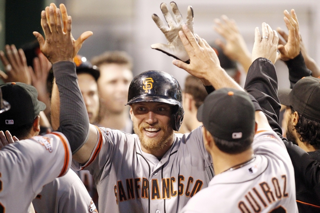 Jun 13, 2013; Pittsburgh, PA, USA; San Francisco Giants right fielder Hunter Pence (center) is congratulated in the dugout after hitting a three run home run against the Pittsburgh Pirates during the sixth inning at PNC Park. Mandatory Credit: Charles LeClaire-USA TODAY Sports