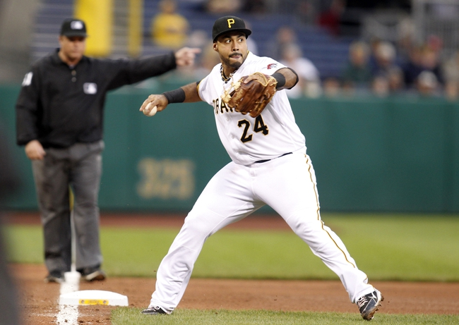 Jun 13, 2013; Pittsburgh, PA, USA; Pittsburgh Pirates third baseman Pedro Alvarez (24) throws to first base to retire a San Francisco Giants batter during the fourth inning at PNC Park. Mandatory Credit: Charles LeClaire-USA TODAY Sports
