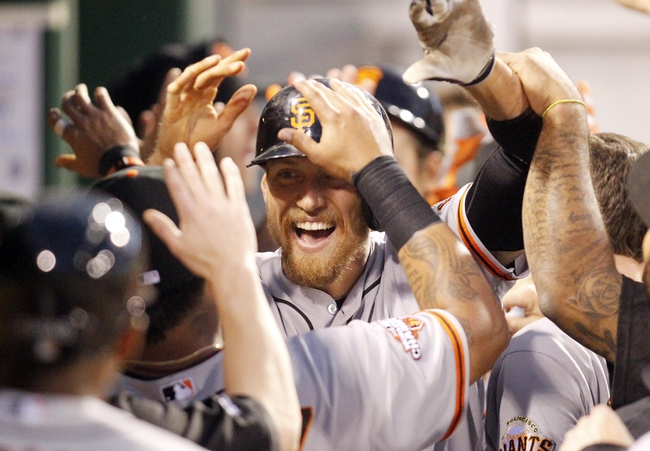 Jun 13, 2013; Pittsburgh, PA, USA; San Francisco Giants right fielder Hunter Pence (center) gets high-fives in the dugout after hitting a three run home run against the Pittsburgh Pirates during the sixth inning at PNC Park. The San Francisco Giants won 10-0. Mandatory Credit: Charles LeClaire-USA TODAY Sports