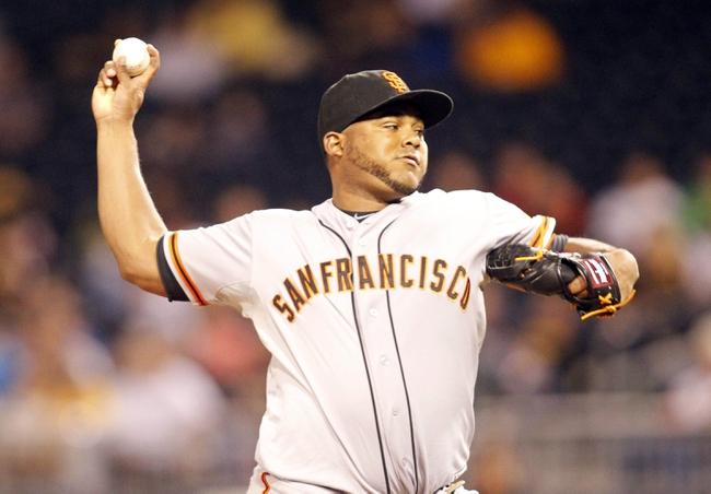 Jun 13, 2013; Pittsburgh, PA, USA; San Francisco Giants relief pitcher Jean Machi (63) pitches against the Pittsburgh Pirates during the eighth inning at PNC Park. The San Francisco Giants won 10-0. Mandatory Credit: Charles LeClaire-USA TODAY Sports
