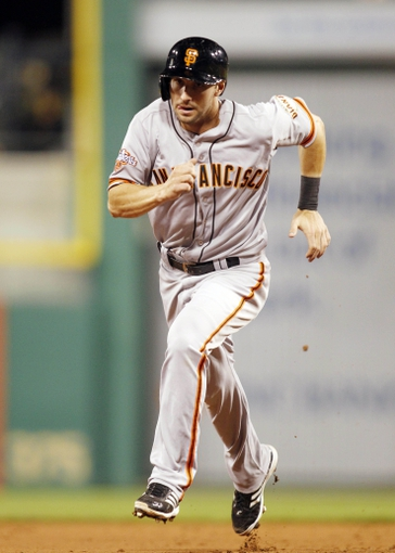 Jun 13, 2013; Pittsburgh, PA, USA; San Francisco Giants second baseman Nick Noonan (21) runs the bases against the Pittsburgh Pirates during the ninth inning at PNC Park. The San Francisco Giants won 10-0. Mandatory Credit: Charles LeClaire-USA TODAY Sports