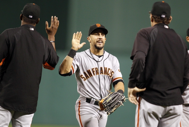 Jun 13, 2013; Pittsburgh, PA, USA; San Francisco Giants left fielder Andres Torres (56) celebrates after defeating the Pittsburgh Pirates at PNC Park. The San Francisco Giants won 10-0. Mandatory Credit: Charles LeClaire-USA TODAY Sports