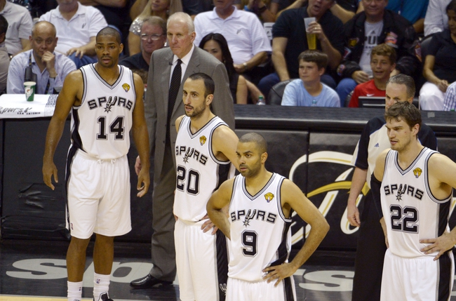 Jun 13, 2013; San Antonio, TX, USA;  San Antonio Spurs point guard Gary Neal (14), head coach Gregg Popovich, Manu Ginobili (20), Tony Parker (9), and Tiago Splitter (22) react against the Miami Heat during the third quarter of game four of the 2013 NBA Finals at the AT&T Center. Mandatory Credit: Brendan Maloney-USA TODAY Sports