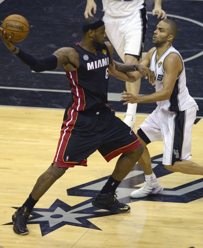 Jun 13, 2013; San Antonio, TX, USA; San Antonio Spurs point guard Tony Parker (9) defends Miami Heat small forward LeBron James (6) during the third quarter of game four of the 2013 NBA Finals at the AT&T Center. Mandatory Credit: Brendan Maloney-USA TODAY Sports
