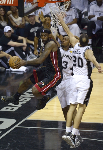 Jun 13, 2013; San Antonio, TX, USA;  Miami Heat small forward LeBron James (6) passes the ball past San Antonio Spurs center Boris Diaw (33) and Manu Ginobili (20) during the fourth quarter of game four of the 2013 NBA Finals at the AT&T Center. Mandatory Credit: Brendan Maloney-USA TODAY Sports