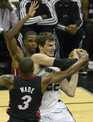 Jun 13, 2013; San Antonio, TX, USA; San Antonio Spurs center Tiago Splitter (22) is defended by Miami Heat shooting guard Dwyane Wade (3) and Chris Bosh (1) during the fourth quarter of game four of the 2013 NBA Finals at the AT&T Center. Mandatory Credit: Brendan Maloney-USA TODAY Sports