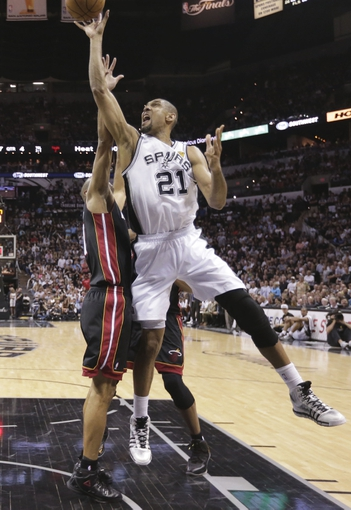Jun 13, 2013; San Antonio, TX, USA;  San Antonio Spurs power forward Tim Duncan (21) shoots defended by Miami Heat small forward Shane Battier (31) during the second half of game four in the 2013 NBA Finals at the AT&T Center. Mandatory Credit: Eric Gay-AP/Pool Photo-USA TODAY Sports