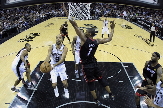 Jun 13, 2013; San Antonio, TX, USA; San Antonio Spurs point guard Tony Parker (9) shoots against Miami Heat center Chris Bosh (1) during the second half of game four in the 2013 NBA Finals at the AT&T Center. Mandatory Credit: Lucy Nicholson/Pool Photo-USA TODAY Sports