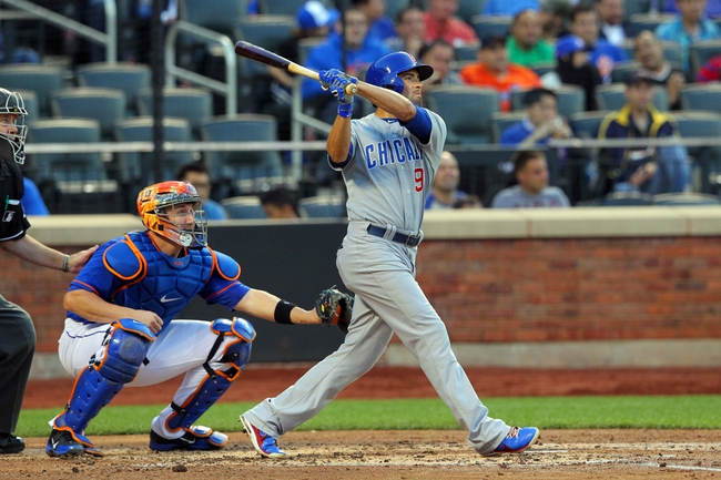 Jun 14, 2013; New York, NY, USA; Chicago Cubs center fielder David DeJesus (9) hits a three-RBI triple against the New York Mets during the second inning of a game at Citi Field. Mandatory Credit: Brad Penner-USA TODAY Sports