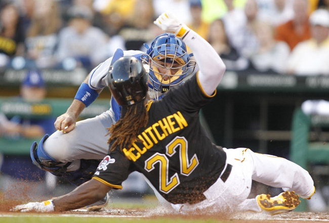 Jun 14, 2013; Pittsburgh, PA, USA; Los Angeles Dodgers catcher A.J. Ellis (17) tags out Pittsburgh Pirates center fielder Andrew McCutchen (22) at the plate during the third inning at PNC Park. Mandatory Credit: Charles LeClaire-USA TODAY Sports