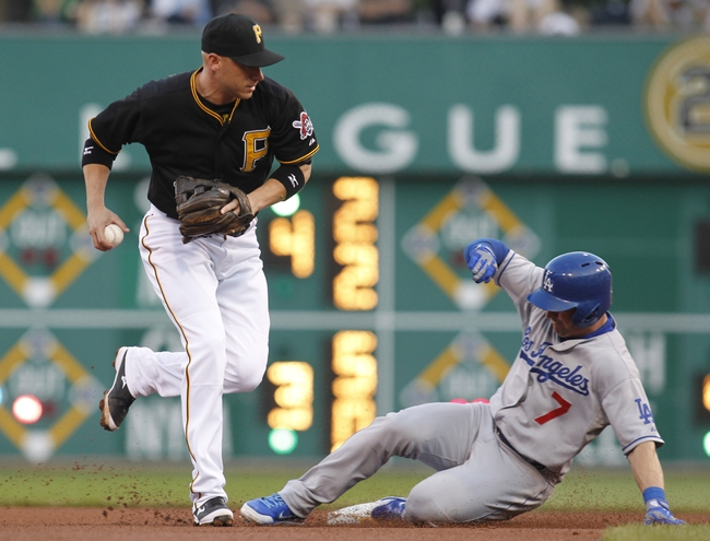 Jun 14, 2013; Pittsburgh, PA, USA; Los Angeles Dodgers second baseman Nick Punto (7) slides into second base prohibiting Pittsburgh Pirates shortstop Clint Barmes (12) from completing a double play during the fourth inning at PNC Park. The Pittsburgh Pirates won 3-0. Mandatory Credit: Charles LeClaire-USA TODAY Sports