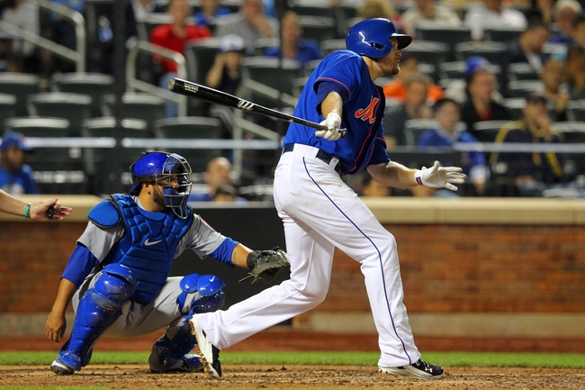 Jun 14, 2013; New York, NY, USA; New York Mets left fielder Lucas Duda (21) hits an RBI single against the Chicago Cubs during the seventh inning of a game at Citi Field. Mandatory Credit: Brad Penner-USA TODAY Sports