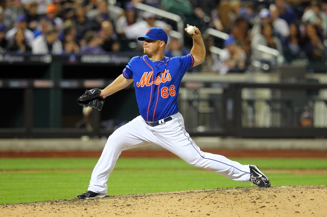 Jun 14, 2013; New York, NY, USA; New York Mets relief pitcher Josh Edgin (66) pitches against the Chicago Cubs during the eighth inning of a game at Citi Field. Mandatory Credit: Brad Penner-USA TODAY Sports