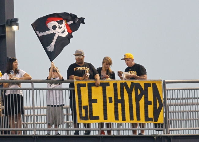 Jun 14, 2013; Pittsburgh, PA, USA; Pittsburgh Pirates fans cheer on the left field rotunda against the Los Angeles Dodgers during the sixth inning at PNC Park. The Pittsburgh Pirates won 3-0. Mandatory Credit: Charles LeClaire-USA TODAY Sports