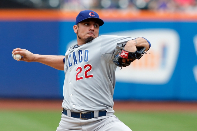 Jun 16, 2013; Flushing, NY,USA;  Chicago Cubs starting pitcher Matt Garza (22) pitches during the first inning against the New York Mets at Citi Field.  Mandatory Credit: Anthony Gruppuso-USA TODAY Sports