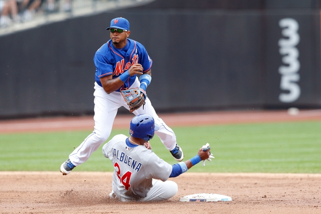 Jun 16, 2013; Flushing, NY,USA;  Chicago Cubs third baseman Luis Valbuena (24) is forced out by New York Mets second baseman Jordany Valdespin (1) during the third inning at Citi Field.  Mandatory Credit: Anthony Gruppuso-USA TODAY Sports