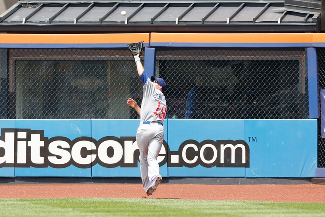 Jun 16, 2013; Flushing, NY,USA;  Chicago Cubs right fielder Nate Schierholtz (19) fields a ball for an out during the third inning against the New York Mets at Citi Field.  Mandatory Credit: Anthony Gruppuso-USA TODAY Sports