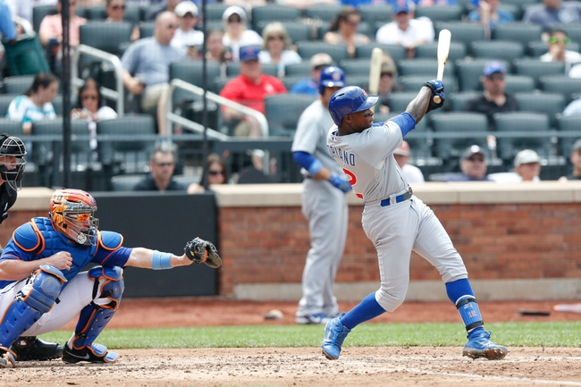 Jun 16, 2013; Flushing, NY,USA;  Chicago Cubs left fielder Alfonso Soriano (12) goes safe to first on a throwing error as two runners score during the fifth inning against the New York Mets at Citi Field.  Mandatory Credit: Anthony Gruppuso-USA TODAY Sports