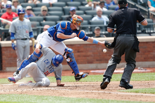 Jun 16, 2013; Flushing, NY,USA;  Chicago Cubs right fielder Nate Schierholtz (19) slides home as New York Mets catcher John Buck (44) misplays the ball during the fifth inning at Citi Field.  Mandatory Credit: Anthony Gruppuso-USA TODAY Sports