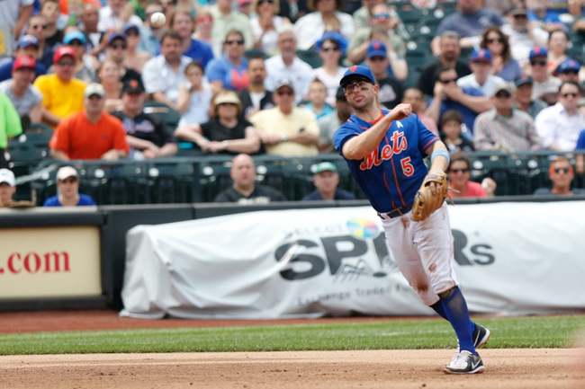 Jun 16, 2013; Flushing, NY,USA;  New York Mets third baseman David Wright (5) overthrows to first during the fifth inning against the Chicago Cubs at Citi Field.  Mandatory Credit: Anthony Gruppuso-USA TODAY Sports