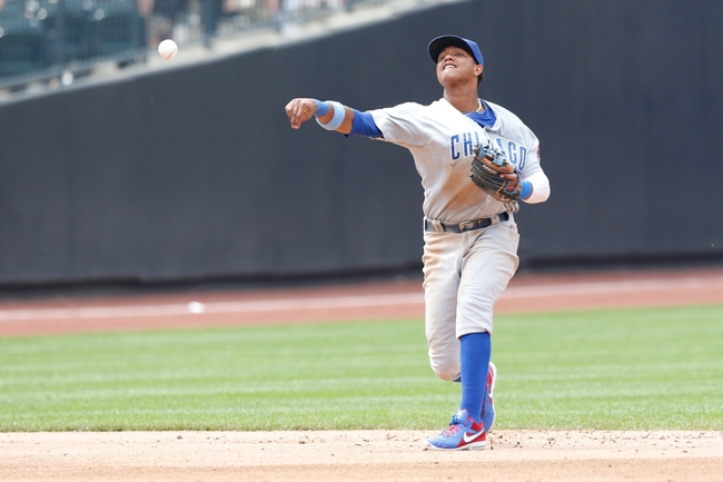 Jun 16, 2013; Flushing, NY,USA;  Chicago Cubs shortstop Starlin Castro (13) overthrows the ball during the sixth inning against the New York Mets at Citi Field.  Mandatory Credit: Anthony Gruppuso-USA TODAY Sports