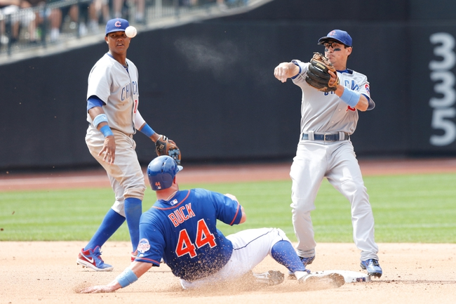 Jun 16, 2013; Flushing, NY,USA;  New York Mets catcher John Buck (44) is out at second as Chicago Cubs second baseman Darwin Barney (15) fails to complete the double play during the seventh inning at Citi Field.  Mandatory Credit: Anthony Gruppuso-USA TODAY Sports