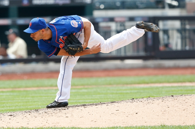 Jun 16, 2013; Flushing, NY,USA;  New York Mets relief pitcher Carlos Torres (52) delivers a pitch during the sixth inning against the Chicago Cubs at Citi Field.  Mandatory Credit: Anthony Gruppuso-USA TODAY Sports