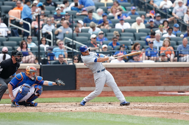 Jun 16, 2013; Flushing, NY,USA;  Chicago Cubs second baseman Darwin Barney (15) singles to right during the sixth inning against the New York Mets at Citi Field.  Mandatory Credit: Anthony Gruppuso-USA TODAY Sports