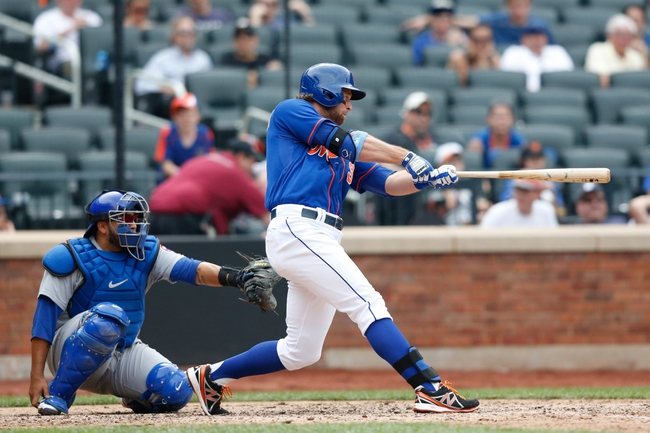 Jun 16, 2013; Flushing, NY,USA;  New York Mets center fielder Kirk Nieuwenhuis (9) hits a three run walk off home run during the ninth inning against the Chicago Cubs at Citi Field.  Mets won 4-3.  Mandatory Credit: Anthony Gruppuso-USA TODAY Sports