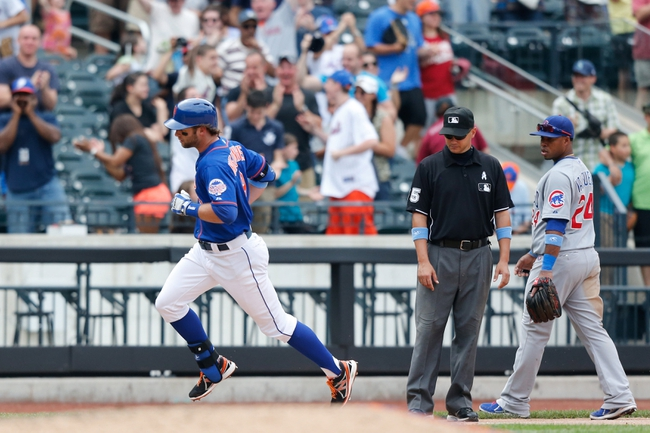Jun 16, 2013; Flushing, NY,USA;  New York Mets center fielder Kirk Nieuwenhuis (9) rounds the bases on his three run walk off home run during the ninth inning against the Chicago Cubs at Citi Field.  Mets won 4-3.  Mandatory Credit: Anthony Gruppuso-USA TODAY Sports