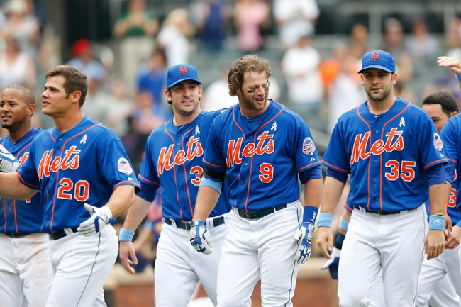 Jun 16, 2013; Flushing, NY,USA;  New York Mets center fielder Kirk Nieuwenhuis (9) celebrates his three run walk off home run with teammates during the ninth inning against the Chicago Cubs at Citi Field.  Mets won 4-3.  Mandatory Credit: Anthony Gruppuso-USA TODAY Sports