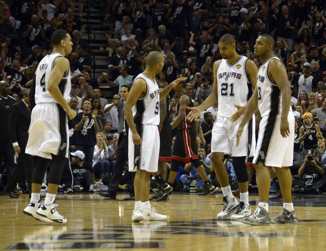 Jun 16, 2013; San Antonio, TX, USA; San Antonio Spurs power forward Tim Duncan (21), Tony Parker (9) Danny Green (14) and Boris Diaw (33) celebrate against the Miami Heat during the fourth quarter of game five in the 2013 NBA Finals at the AT&T Center. Mandatory Credit: Brendan Maloney-USA TODAY Sports