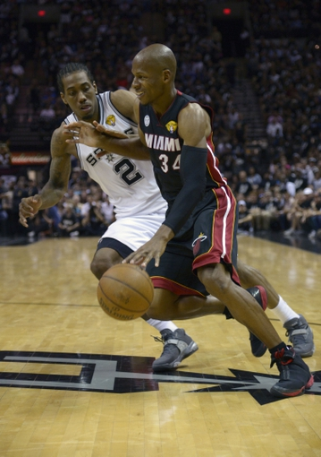 Jun 16, 2013; San Antonio, TX, USA; Miami Heat shooting guard Ray Allen (34) drives to the basket defended by San Antonio Spurs small forward Kawhi Leonard (2) during the fourth quarter of game five in the 2013 NBA Finals at the AT&T Center. Mandatory Credit: Brendan Maloney-USA TODAY Sports