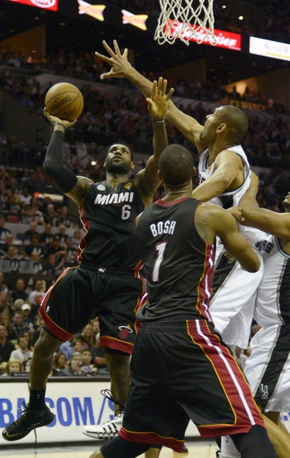 Jun 16, 2013; San Antonio, TX, USA; Miami Heat small forward LeBron James (6) shoots defended by San Antonio Spurs power forward Tim Duncan (21) during the fourth quarter of game five in the 2013 NBA Finals at the AT&T Center. Mandatory Credit: Brendan Maloney-USA TODAY Sports