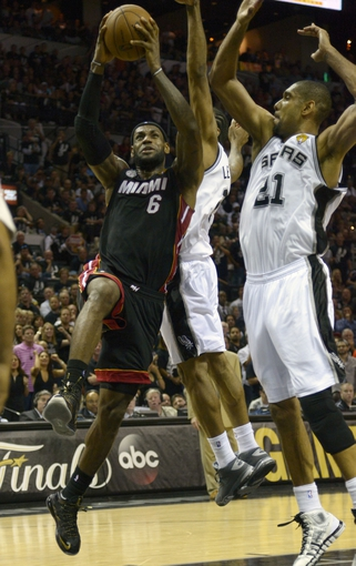 Jun 16, 2013; San Antonio, TX, USA;  Miami Heat small forward LeBron James (6) drives past San Antonio Spurs power forward Tim Duncan (21) during the fourth quarter of game five in the 2013 NBA Finals at the AT&T Center. Mandatory Credit: Brendan Maloney-USA TODAY Sports