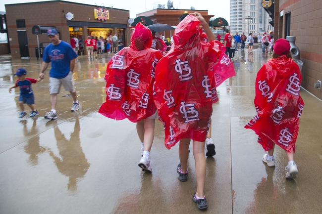 Jun 17, 2013; St. Louis, MO, USA; Fans wait during a rain delay before the game between the St. Louis Cardinals and the Chicago Cubs at Busch Stadium. Mandatory Credit: Scott Rovak-USA TODAY Sports