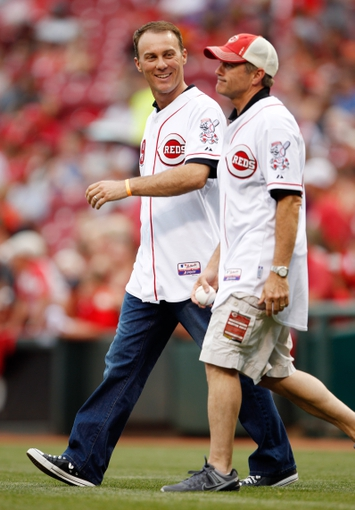 Jun 17, 2013; Cincinnati, OH, USA; NASCAR Sprint Cup Series drivers Kevin Harvick (left) and Bobby Labonte (right) walk to the mound to throw out the first pitch prior to the game against the Cincinnati Reds and the Pittsburgh Pirates at Great American Ball Park. Mandatory Credit: Frank Victores-USA TODAY Sports