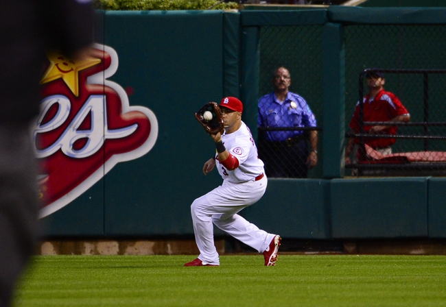 Jun 17, 2013; St. Louis, MO, USA; St. Louis Cardinals right fielder Carlos Beltran (3) makes a catch against the Chicago Cubs at Busch Stadium. Mandatory Credit: Scott Rovak-USA TODAY Sports