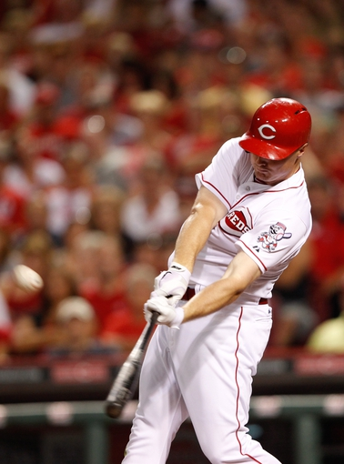 Jun 17, 2013; Cincinnati, OH, USA; Cincinnati Reds right fielder Jay Bruce (32) hits a home run during the eighth inning against the Pittsburgh Pirates at Great American Ball Park. The Reds defeated the Pirates 4-1. Mandatory Credit: Frank Victores-USA TODAY Sports