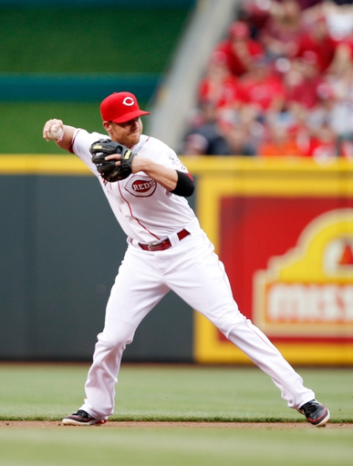 Jun 17, 2013; Cincinnati, OH, USA; Cincinnati Reds shortstop Zack Cozart (2) makes a play during the first inning against the Pittsburgh Pirates at Great American Ball Park. Mandatory Credit: Frank Victores-USA TODAY Sports