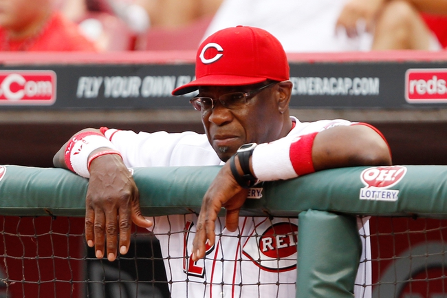 Jun 17, 2013; Cincinnati, OH, USA; Cincinnati Reds manager Dusty Baker (12) in the dug out during the first inning against the Pittsburgh Pirates at Great American Ball Park. Mandatory Credit: Frank Victores-USA TODAY Sports