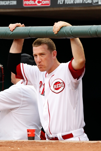 Jun 17, 2013; Cincinnati, OH, USA; Cincinnati Reds third baseman Todd Frazier (21) in the dug out prior to the game against the Pittsburgh Pirates at Great American Ball Park. Mandatory Credit: Frank Victores-USA TODAY Sports