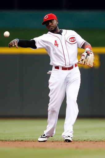 Jun 17, 2013; Cincinnati, OH, USA; Cincinnati Reds second baseman Brandon Phillips (4) makes a play during the second inning against the Pittsburgh Pirates at Great American Ball Park. Mandatory Credit: Frank Victores-USA TODAY Sports