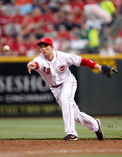 Jun 17, 2013; Cincinnati, OH, USA; Cincinnati Reds first baseman Joey Votto (19) makes a play during the second inning against the Pittsburgh Pirates at Great American Ball Park. Mandatory Credit: Frank Victores-USA TODAY Sports
